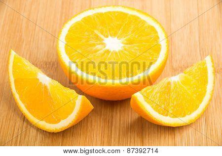 Few Slices Of Orange Lying On Table