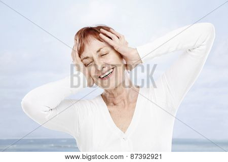 Happy senior woman on summer holiday