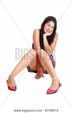 Girl Sitting On Floor.