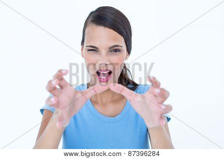 Furious woman with hands up on white background