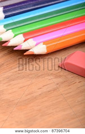 Pencil Set On Wooden Plate With Eraser