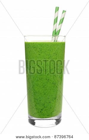 Green smoothie in glass with straws isolated on white