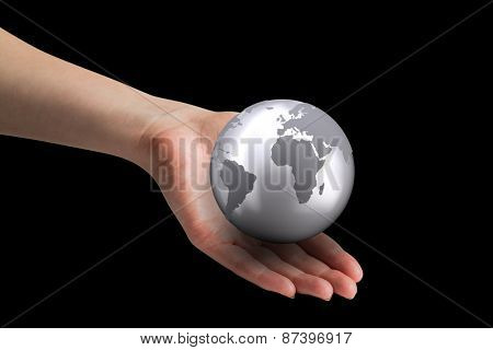 Hand presenting against silver earth