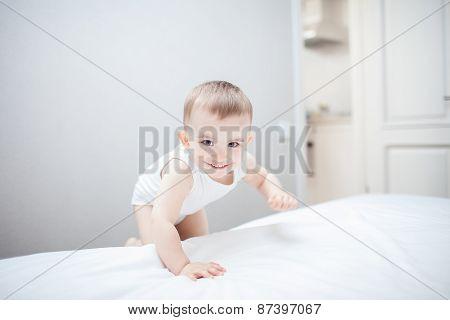 Cute baby boy in bed