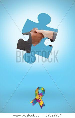 Business handshake against blue background with vignette