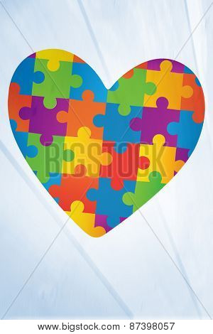 Autism awareness heart against bleached wooden planks background