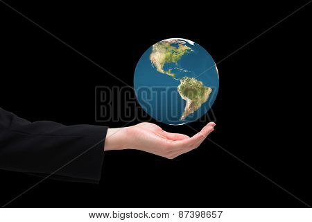 Businesswomans hand presenting against earth