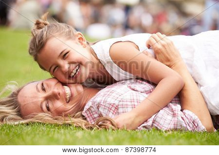 Mother And Daughter Relaxing At Outdoor Summer Event