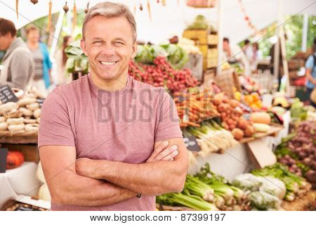 Male Stall Holder At Farmers Fresh Food Market