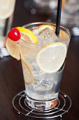 stock photo of collins  - Tom Collins cocktail shot on a bar counter - JPG