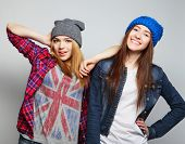 pic of crazy hat  - Fashion portrait of two stylish sexy hipster girls best friends - JPG