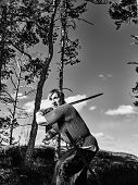 picture of viking  - Medieval viking warrior wearing chainmail and he has the sword north nature on background black and white image - JPG