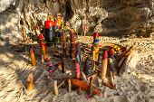 image of cave  - Wooden phalluses in Pranang cave - JPG