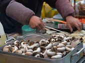 foto of marshes  - Merchant cooking food from boiled Pond Snail  - JPG