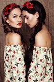 pic of headband  - fashion studio photo of two beautiful girls with dark hair in dresses with prints of red poppies and with headbands - JPG