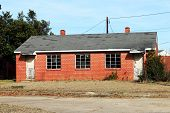 stock photo of public housing  - Abandoned public housing structure.  These brick houses were built over 50 years ago to house poor families as part of a government assistance program. ** Note: Soft Focus at 100%, best at smaller sizes - JPG