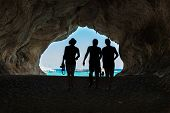 stock photo of cave  - People in the big cave view from inside - JPG