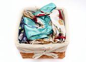 image of underthings  - clothes basket full of lingerie over white - JPG