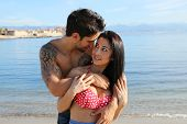 picture of cuddle  - beautiful couple doing cuddle on the beach - JPG