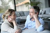 picture of sofa  - Mature couple talking to each other in sofa - JPG