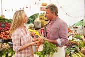 pic of farmers market vegetables  - Woman Buying Fresh Vegetables At Farmers Market Stall - JPG