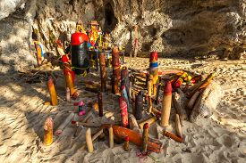 stock photo of phallus  - Wooden phalluses in Pranang cave - JPG