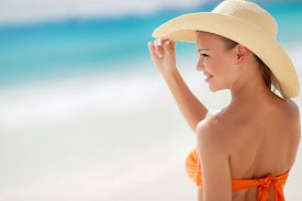 picture of sunbathers  - A woman with a beautiful figure - JPG