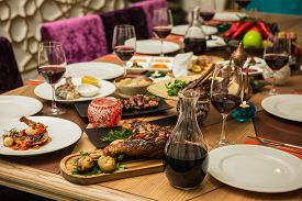 stock photo of banquet  - Served for a banquet table. Wine glasses with napkins, glasses and salads. ** Note: Shallow depth of field - JPG