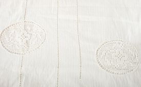 stock photo of stitches  - Old white tablecloth with english stitching - JPG