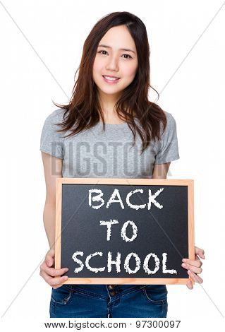 Woman hand hold with blackboard and showing phrase of back to school