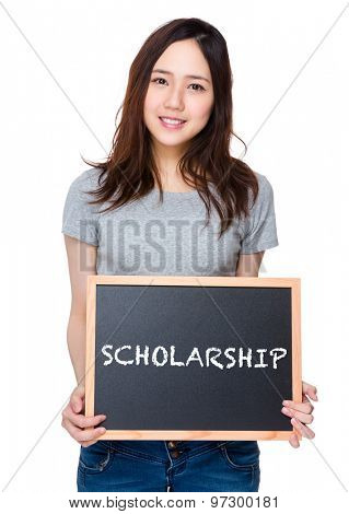 Woman hand hold with blackboard and showing a word scholarship