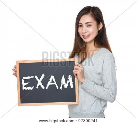 Pretty woman hold with blackboard and showing a word exam