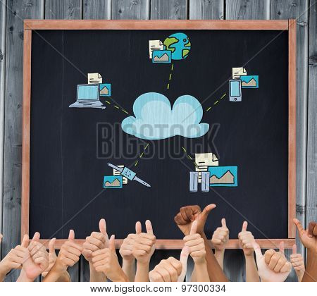 Hands giving thumbs up against blackboard with copy space on wooden board