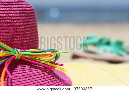 Summer Hat And Flip Flops On A Beach