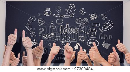 Group of hands giving thumbs up against black chalkboard