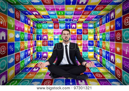 Peaceful businessman sitting in lotus pose relaxing against app room