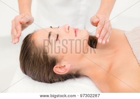 Beautiful young woman on massage table at spa center