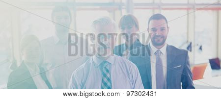 Double exposure with  low poly design. Senior businessman with his team at office. business people group