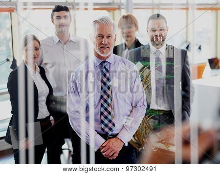Double exposure design. Senior businessman with his team at office. business people group