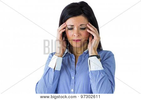 Businesswoman getting a headache on white background