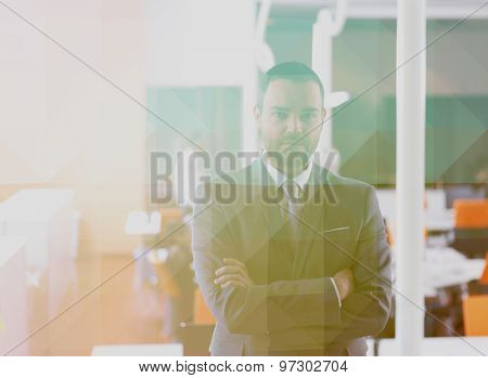 Double exposure with  low poly design. Happy young business man portrait  at modern meeting office indoors