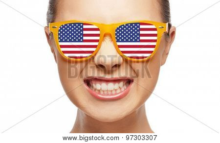 people, patriotism, national pride and independence day concept - angry teenage girl in sunglasses with american flag