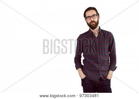 Handsome hipster looking at camera on white background