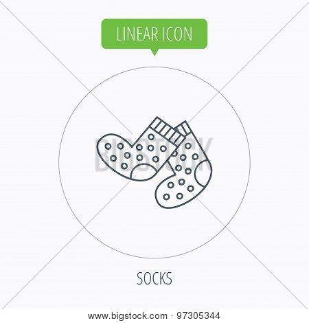 Socks icon. Baby underwear sign.
