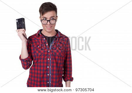 portrait of a young attractive man with a camera in hand isolated on white background . copy space