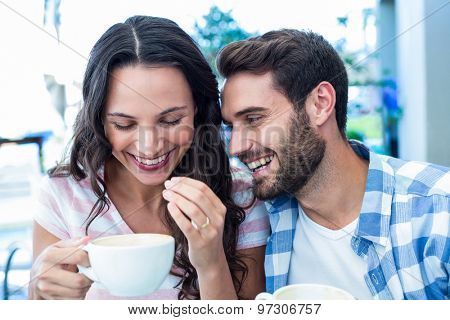 Cute couple having coffee together in cafe