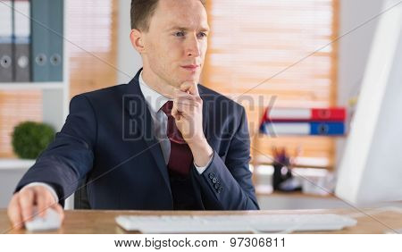 Focused businessman working at his desk in his office