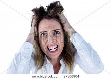 Stressed businesswoman with hands on her head on white background
