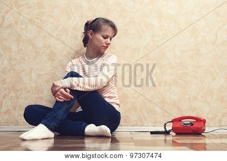 Sad Girl Near The Phone