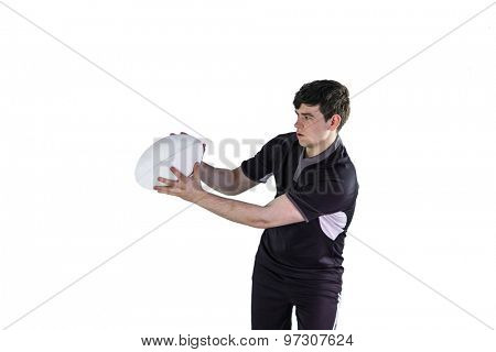 Rugby player receiving a side pass on a white background